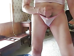 Panty coward masturbates with the addition of squirts